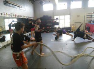 stations focusing on different exercises in a strength and conditioning class at Lanna MMA in Vaughan