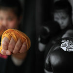 picture of a girl throwing a punch with hand wraps and throwing the same punch with gloves on, side by side. The girl is a boxing student at Lanna MMA located in Vaughan and North York
