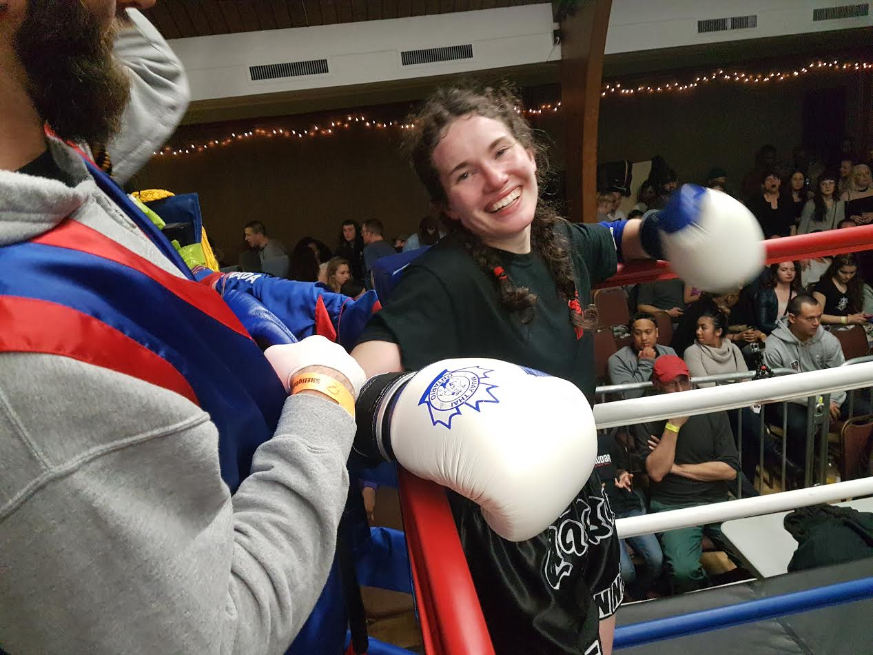 Tyya looking happy after winning her Muay Thai Fight in SheFights Female Muay Thai Event