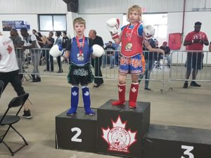 Andre on the podium after placing 1st in the Muay Thai Ontario Provincial Tournament