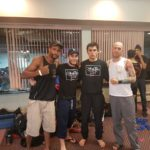 17 year old Omid with his 2 coaches and a team mate, all in Lanna gear, posing after Omids Muay Thai Kickboxing fight