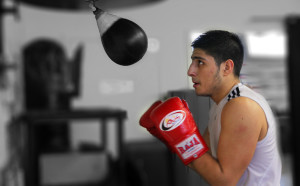 student in boxing gloves getting ready to hit the speed big in a boxing class at Lanna MMA in Vaughan