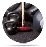 Strength and conditioning equipment such as kettlebells, hammers, and medicine balls that are used in the classes at Lanna MMA in Vaughan