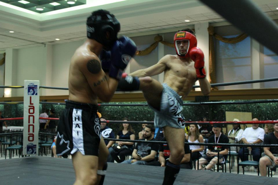 Fighters throwing a kick and other fighter block in a muay thai fight in Vaughan