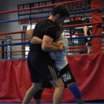 Two students working on their greco roman wrestling and grappling in an MMA class at Lanna MMA in Vaughan Ontario