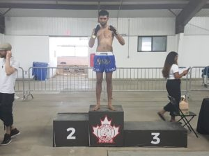 Leon on the podium after winning 2 fights to claim the Muay Thai Ontario Provincial Tournament B Class 125 Lb Championship
