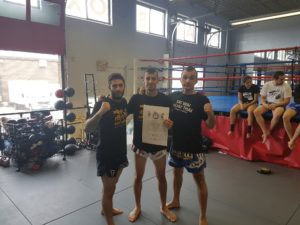 David posing with his coaches Jordan and Jovan as he gets his Kru certificate in Muay Thai at Lanna MMA in Vaughan and North York